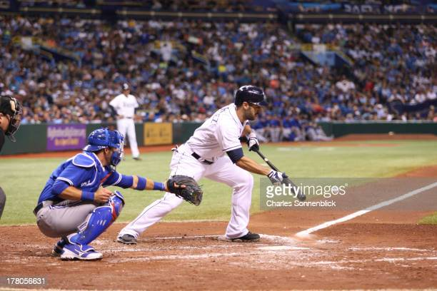 Sean Rodriguez of the Tampa Bay Rays lays down a bunt down the third base line that rolls foul in the third inning against the Toronto Blue Jays...