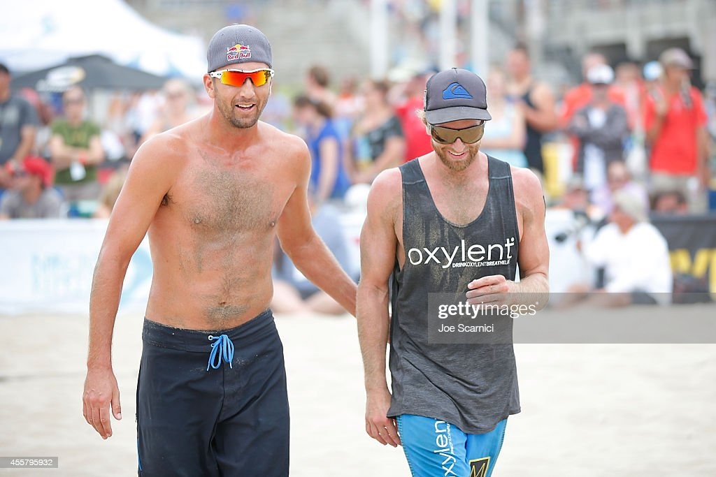 Sean Rosenthal and Ty Tramblie react to a point during their match against Brad Keenan and John Mayer at the AVP Championships at Huntington Beach on September 20, 2014 in Huntington Beach, California.