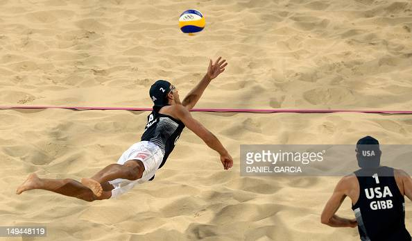 US' Sean Rosenthal dives for the ball next to teammate Jacob Gibb during the men's beach volleyball preliminary phase Pool D match US vs South Africa...