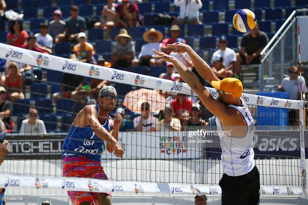 <a gi-track='captionPersonalityLinkClicked' href=/galleries/search?phrase=Sean+Rosenthal&family=editorial&specificpeople=568386 ng-click='$event.stopPropagation()'>Sean Rosenthal</a> (L) of USA spikes the ball over Stefan Gunnarsson of Sweden during the round of pool play at the ASICS World Series of Beach Volleyball - Day 3 on July 24, 2013 in Long Beach, California.