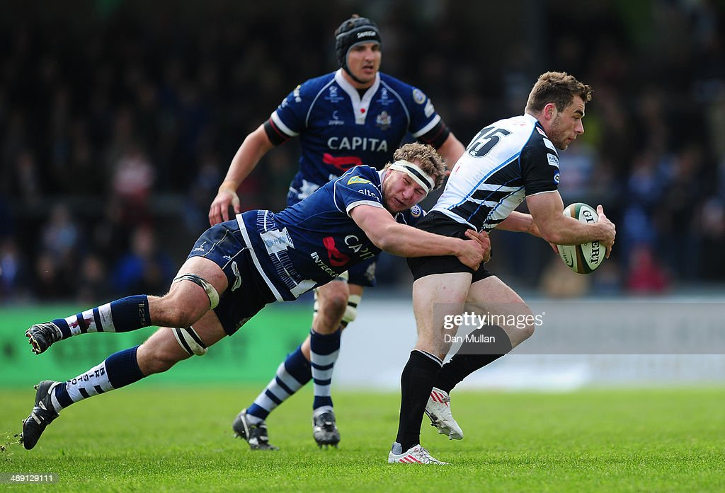 Sean Scanlon of Rotherham Titans is tackled by Nick Koster of Bristol during the Greene King IPA Championship Play Off First Leg match between Bristol Rugby and Rotherham Titans at The Memorial Ground on May 10, 2014 in Bristol, England.