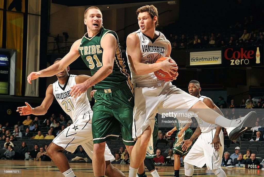 Sean Sheldon #31 of William & Mary and Shelby Moats #34 of the Vanderbilt Commodores jump for a rebound at Memorial Gym on January 2, 2013 in Nashville, Tennessee.