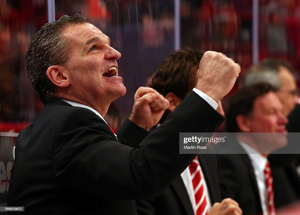 <a gi-track='captionPersonalityLinkClicked' href=/galleries/search?phrase=Sean+Simpson&family=editorial&specificpeople=4607563 ng-click='$event.stopPropagation()'>Sean Simpson</a>, head coach of Swiss celebrates after winning the IIHF World Championship semifinal match between Swiss and USA at Globen Arena on May 18, 2013 in Stockholm, Sweden.