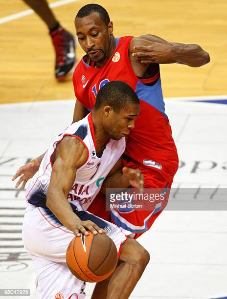 Sean Singletary of Caja Laboral competes with JR Holden of CSKA Moscow during the Euroleague Basketball 20092010 Play Off Game 2 between CSKA Moscow...