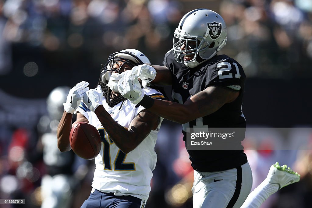 Sean Smith of the Oakland Raiders beaks up a pass intended for Travis Benjamin of the San Diego Chargers during their NFL game at OaklandAlameda...