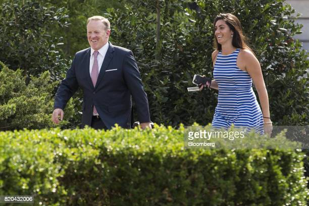 Sean Spicer outgoing White House press secretary left smiles while walking to the West Wing with Vanessa Morrone advisor to the White House Press...