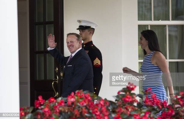 Sean Spicer outgoing White House press secretary left waves while walking to the West Wing with Vanessa Morrone advisor to the White House Press...