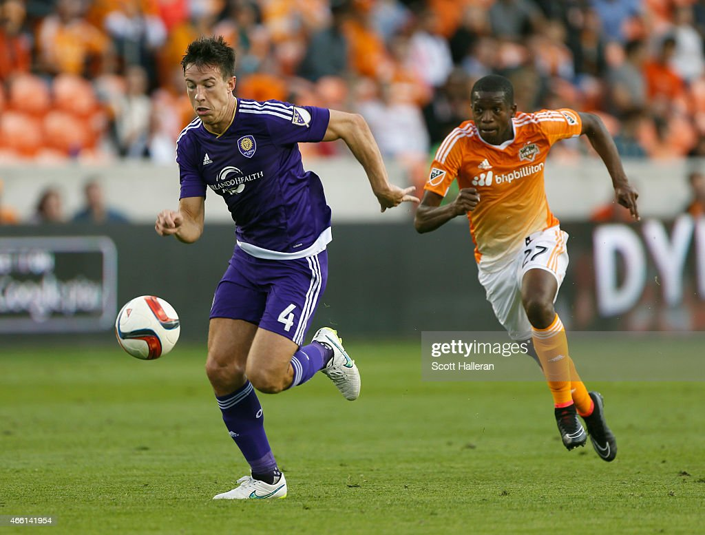 Sean St. Ledger #4 of the Orlando City SC battles for the ball with Boniek Garcia #27 of the Houston Dynamo during their game at BBVA Compass Stadium on March 13, 2015 in Houston, Texas.