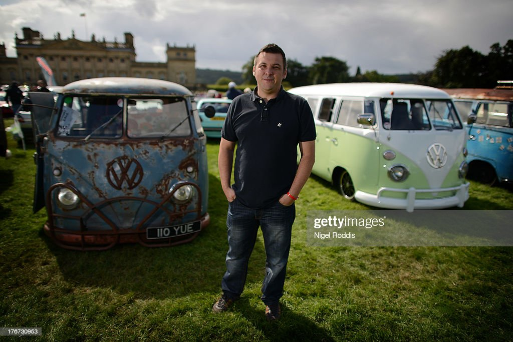 Sean Starbuck of Bradford with his 1967 VW splitsceen VW (L) on display during the 'In Praise Of All Things VW At The Annual Festival' at Harewood House on August 18, 2013 in Leeds, England. The annual VW festival is in its 9th year attracting around 15,000 people over the weekend, ending with the winners car parade on Sunday.