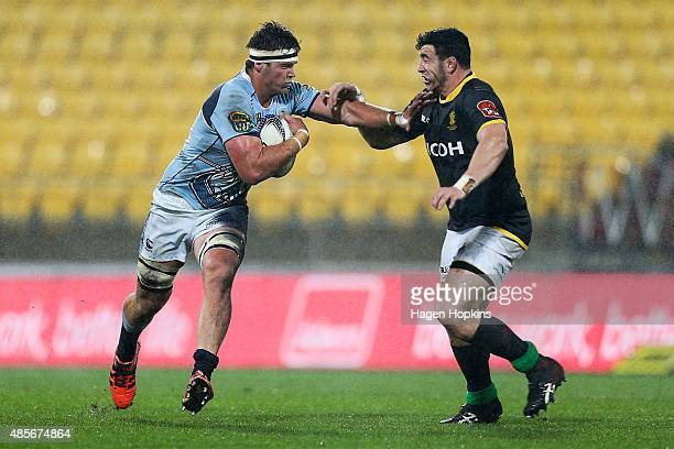 Sean Sweetman of Northland fends Jeffery To'omagaAllen of Wellington during the round three ITM Cup match between Wellington and Northland at Westpac...