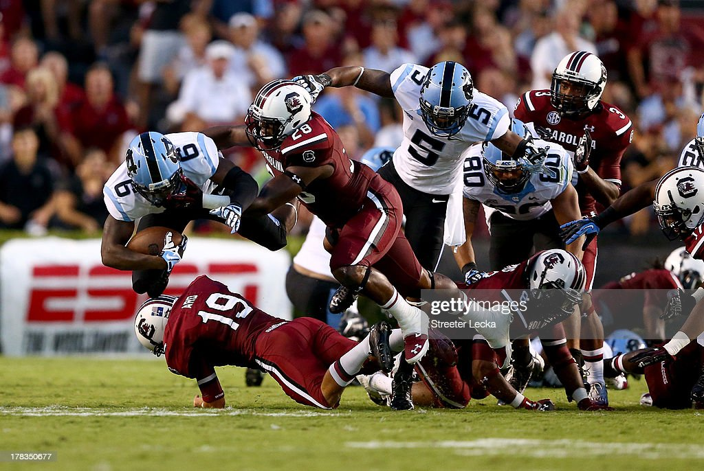 Sean Tapley #6 of the North Carolina Tar Heels is tackled by Jonathan Walton #28 of the South Carolina Gamecocks during their game at Williams-Brice Stadium on August 29, 2013 in Columbia, South Carolina.