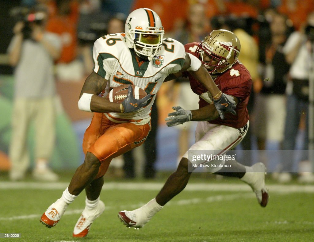 Sean Taylor of the Miami Hurricanes tries to elude PK Sam of the Florida State Seminoles after making an interception during the Orange Bowl January...