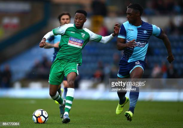 Sean Theobald of Letherhead is challenged by Anthony Stewart of Wycombe Wanderers during The Emirates FA Cup Second Round between Wycombe Wanderers...