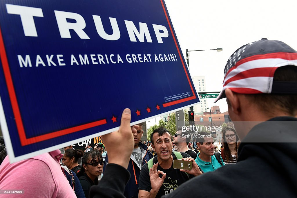Sean Valdez talks to a Pro-Trump supporter during an Anti-Trump rally at the corner of 14th and California in Denver, Colorado on June 1, 2016.
