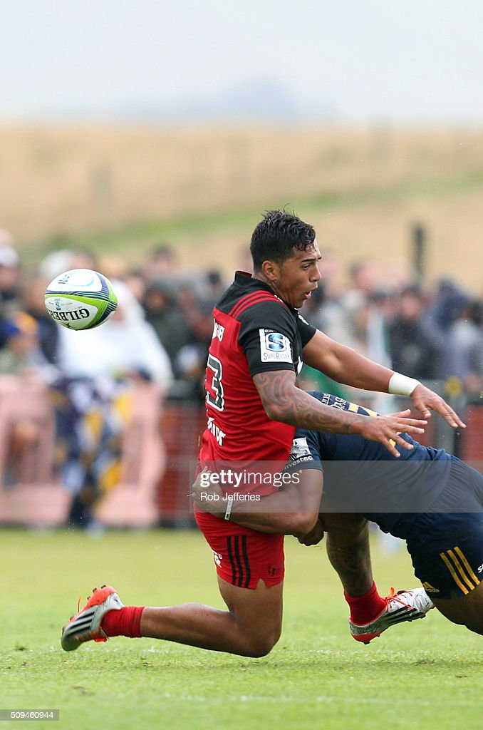 Sean Wainui of the Crusaders is hit hard by <a gi-track='captionPersonalityLinkClicked' href=/galleries/search?phrase=Malakai+Fekitoa&family=editorial&specificpeople=9630619 ng-click='$event.stopPropagation()'>Malakai Fekitoa</a> of the Highlanders during the Super Rugby trial match between the Highlanders and the Crusaders at Fred Booth Park on February 11, 2016 in Waimumu, New Zealand.