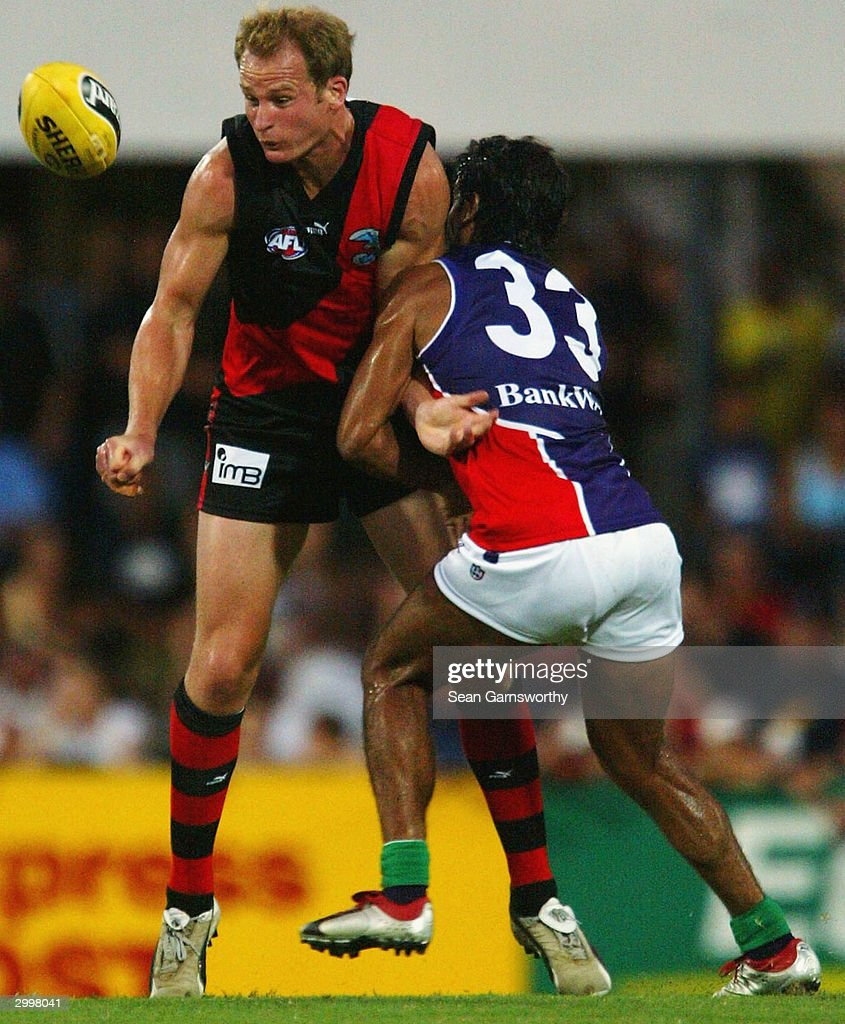 Sean Wellman for Essendon and Jeff Farmer for Fremantle in action during the AFL Wizard Cup match between the Essendon Bombers and Fremantle Dockers...