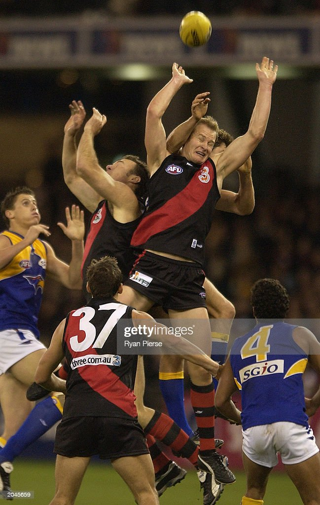 Sean Wellman for the Bombers flys over the pack during the Round 10 AFL match June 1 2003 between the Essendon Bombers and the West Coast Eagles at...