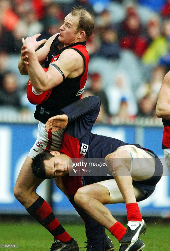 Sean Wellman for the Bombers marks over Adem Yze for the Demons during the round 17 AFL match between the Essendon Bombers and the Melbourne Demons...