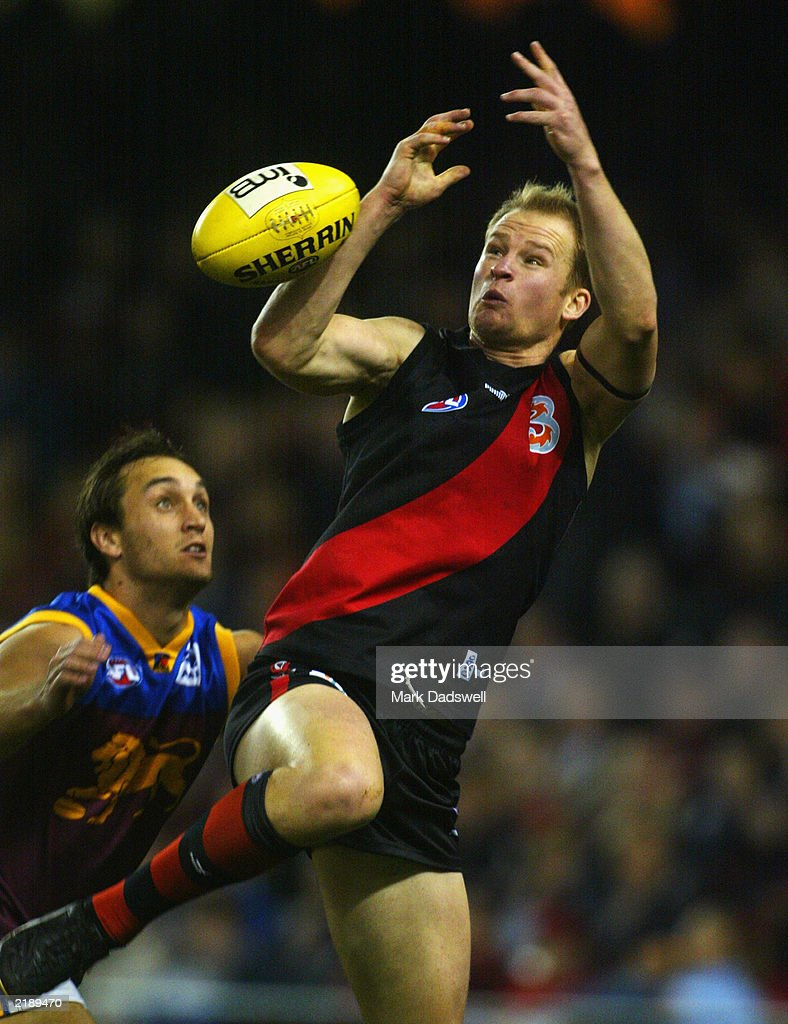 Sean Wellman of the Bombers has a mark spoiled by Daniel Bradshaw of the Lions during the round 16 AFL match between the Essendon Bombers and the...