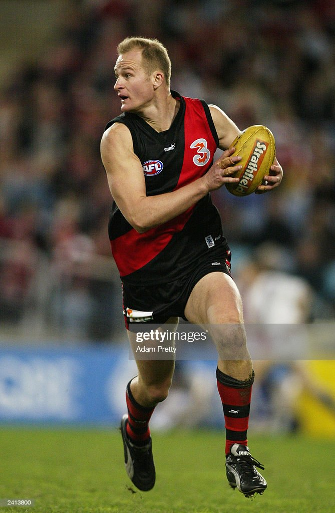 Sean Wellman of the Bombers in action during the round 11 AFL match between the Sydney Swans and the Essendon Bombers at Telstra Stadium June 7 2003...