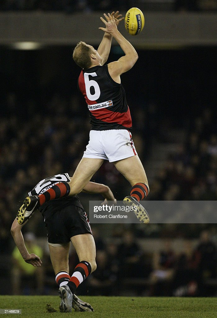 Sean Wellman of the Bombers jumps over Justin Koschitzke of the Saints to take a mark during the round 14 AFL match between the St Kilda Saints and...