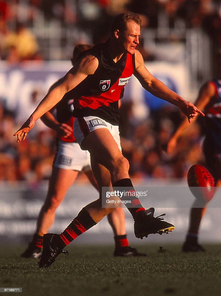 Sean Wellman of the Bombers kicks during the round six AFL match between Essendon and the Western Bulldogs in Melbourne Australia