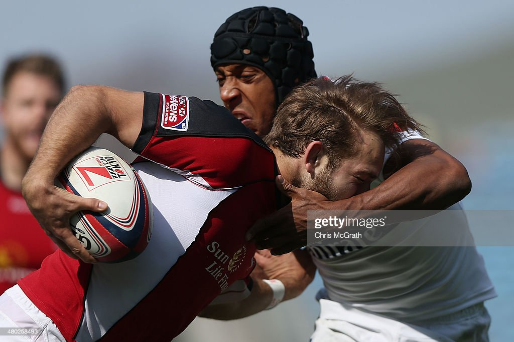 Sean White #1 of Canada is tackled by Nick Edwards #2 of the USA during the Tokyo Sevens, in the six round of the HSBC Sevens World Series at the Prince Chichibu Memorial Ground on March 23, 2014 in Tokyo, Japan.