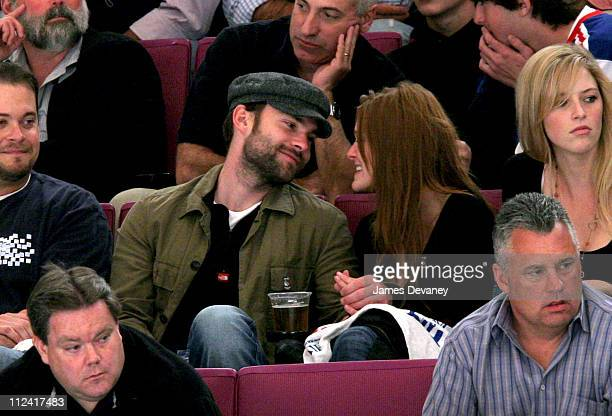 Sean William Scott and Deanna Miller during Celebrities Attend New Jersey Devils vs New York Rangers Playoff Game April 29 2006 at Madison Square...