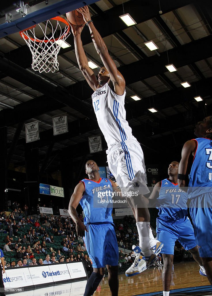 Sean Williams #12 of the Texas Legends dunks against <a gi-track='captionPersonalityLinkClicked' href=/galleries/search?phrase=Latavious+Williams&family=editorial&specificpeople=6523982 ng-click='$event.stopPropagation()'>Latavious Williams</a> #21 of the Tulsa 66ers in an NBA D-League game on December 14, 2010 at the Dr. Pepper Center in Dallas, Texas.