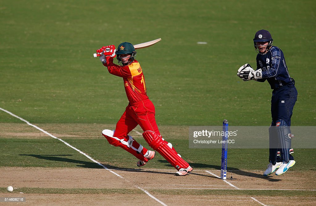 Sean Williams of Zimbabwe in action with Matthew Cross of Scotland during the ICC Twenty20 World Cup Group B match between Scotland and Zimbabwe at...