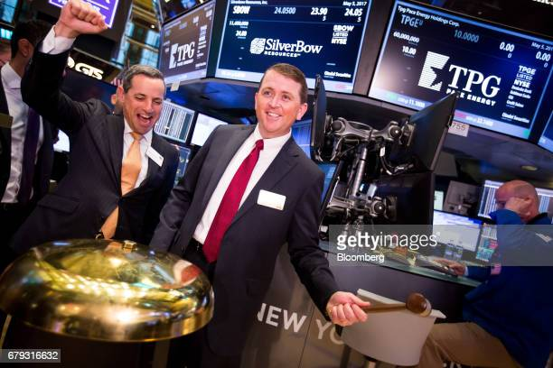 Sean Woolverton chief executive officer of SilverBow Resources Inc center rings a ceremonial bell as the company's common stock commenced trading on...