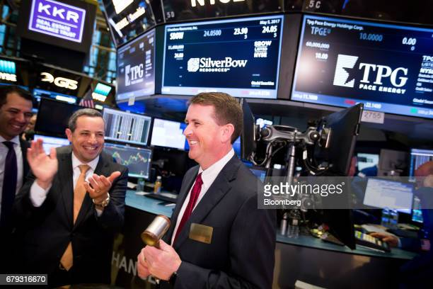 Sean Woolverton chief executive officer of SilverBow Resources Inc center holds a gavel as the company's common stock commenced trading on the floor...