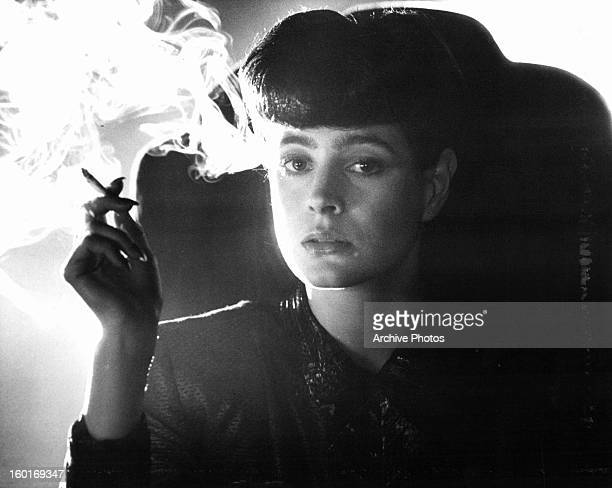 Sean Young smokes in a scene from the film 'Blade Runner' 1982