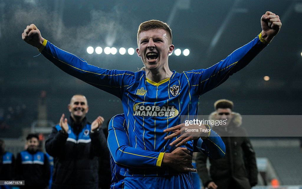 Seanan McKillop of Wimbledon celebrates on the pitch after winning the U18 FA Youth Cup Match between Newcastle United and AFC Wimbledon at St.James' Park on January 6, 2015, in Ilkeston, England.