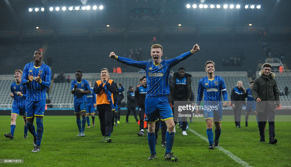 Seanan McKillop (C) of Wimbledon celebrates with teammates on the pitch after winning the U18 FA Youth Cup Match between Newcastle United and AFC Wimbledon at St.James' Park on January 6, 2015, in Ilkeston, England.
