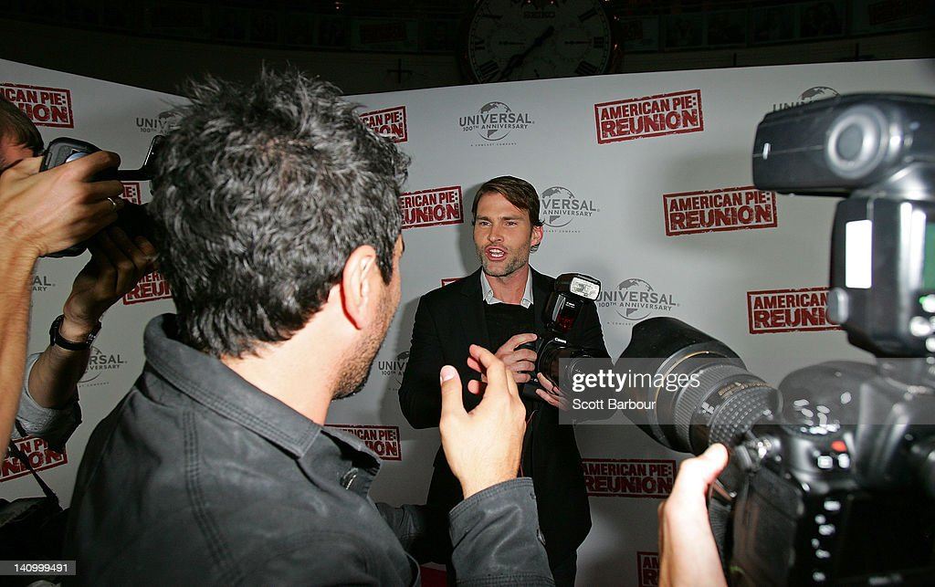 Seann William Scott takes a camera from a photographer as he arrives at the Australian premiere of 'American Pie: Reunion' on March 7, 2012 in Melbourne, Australia.