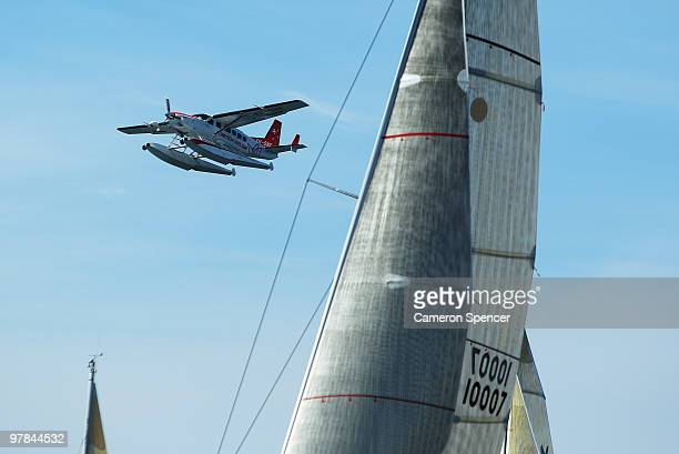 A seaplane fies past yachts during the start of the Sydney Offshore Newcastle Yacht Race on March 19 2010 in Sydney Australia