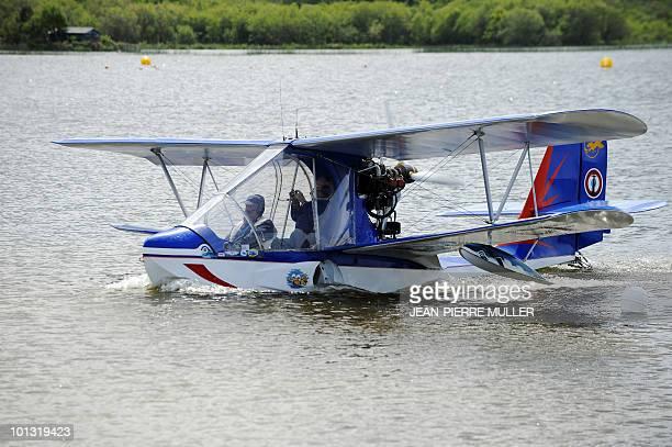 'LE PREMIER HYDRAVION DE HENRI FABRE RESSUSCITE A TRAVERS DEUX REPLIQUES' A seaplane lands on the Lac de Biscarosse during the international...