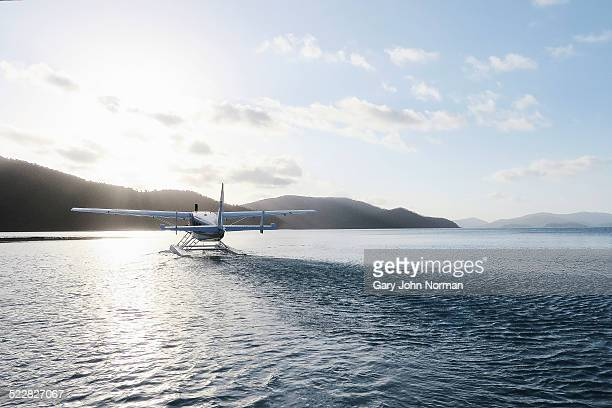 Seaplane leaving island.