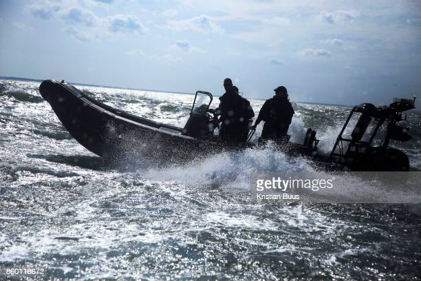 A Search and Marine police unit follow the cargo ship heading off to anchor along side Greenpeace September 21st 2017 Thames Estuary Kent United...