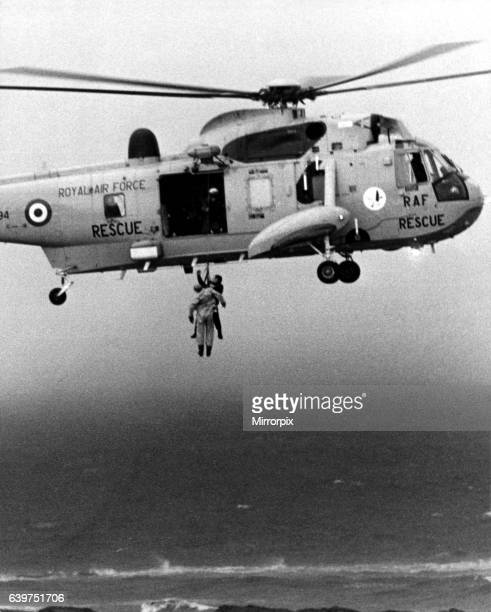 A RAF search and rescue Sea King from RAF Boulmer winches a man onboard plucking him out of the sea off Cullercoats The helicopter had been involved...