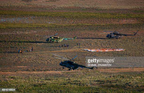Search and rescue team approaches the Soyuz MS03 space capsule carrying the International Space Station crew of Russian cosmonaut Oleg Novitskiy and...