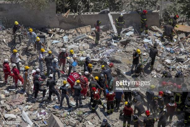 Search and rescue team search in the rubble after two floors collapsed in a small fourstorey building in Torre Annunziata Southern Italy on July 07...