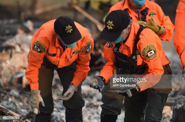 A search and rescue team searches for bodies at a property where a person was reported missing in Santa Rosa California on October 12 2017 Hundreds...