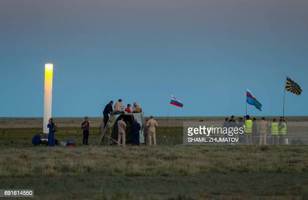 A search and rescue team works at the site of landing of the Soyuz MS03 space capsule in a remote area outside the town of Dzhezkazgan Kazakhstan on...