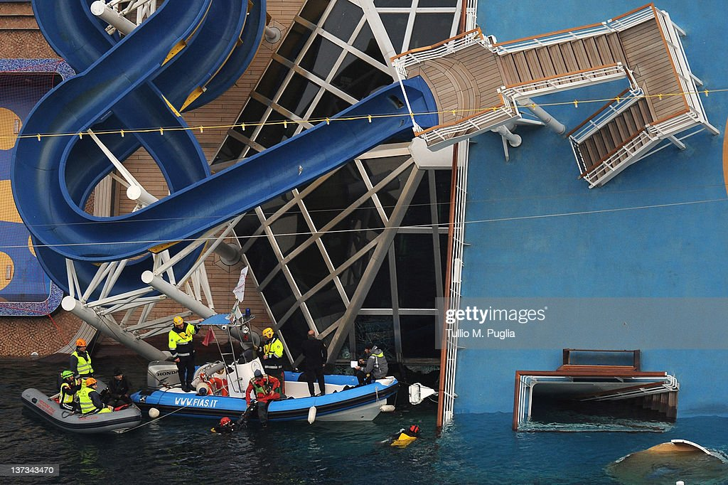 Search and rescue teams continue the search for survivors on the stricken cruise ship Costa Costa Concordia off the island of Giglio on January 19, 2012 in Giglio Porto, Italy. More than four thousand people were on board when the ship hit a rock off the Tuscan coast on Januray 13, 2012. At least 11 people have been confirmed dead while another 24 remain missing.