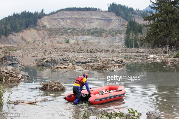 A search and rescue worker looks for survivors in the aftermath of a mudslide on March 25 2014 in Oso Washington A massive mudslide on March 22 has...