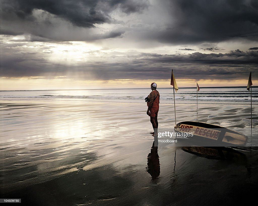 Search and Rescue Worker Standing on the Beach