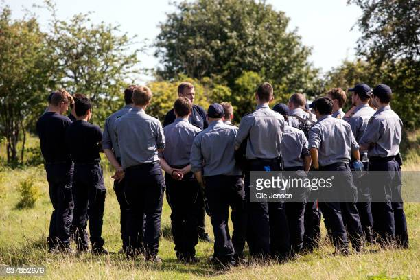 Search team is being briefed upon beginning search for remains of Swedish journalist Kim Wall at the coast line on southern Amager on August 23 2017...