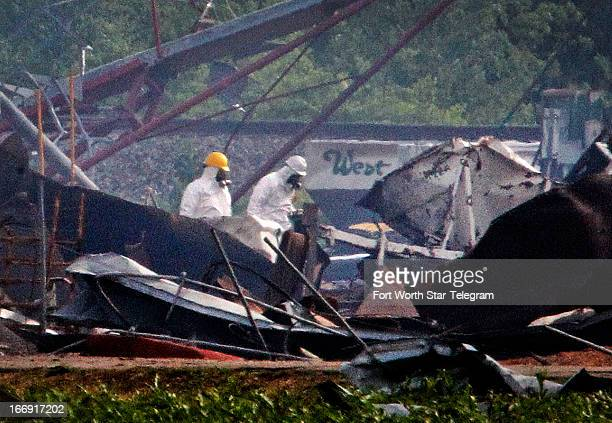 Searchers in protective suits walk through the blast zone of the fertilizer plant that exploded in West Texas on Thursday April 18 2013 The Wednesday...
